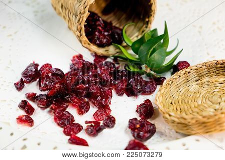 Close up of dried cranberry red dried berries on a white background