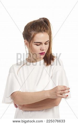 Girl In Summer Dress Plays With Hair.
