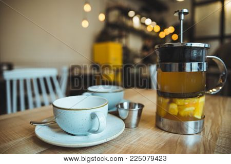 Comfy Cafe Couple Cups And French Press With Tea With Oranges