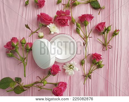 cream cosmetic pink wooden rose bottle, rose pattern