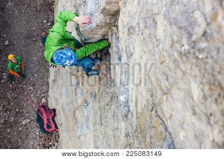 Girl Climber On A Rock