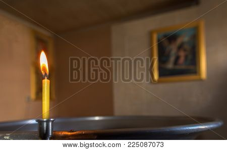 Christening in the church. Catholicism and Orthodoxy, faith. candle on a blurred background. poster