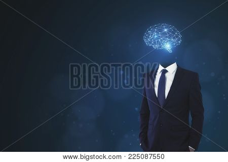 Brain headed businessman standing on dark background with copy space. Brainstorm and innovation concept