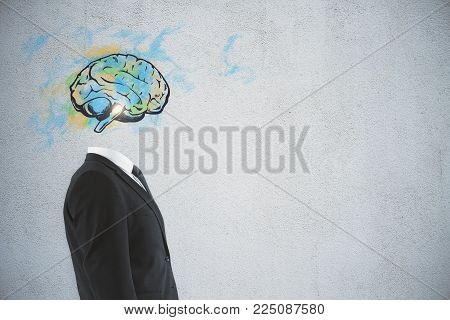 Brain headed businessman standing on dark background with copy space. Brainstorm and intelligence concept