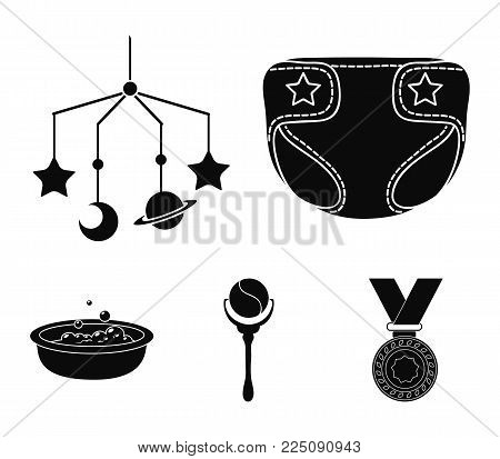 Children's diapers, a toy over the crib, a rattle, a children's bath.Baby born set collection icons in black style vector symbol stock illustration .