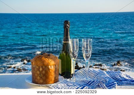 Sweet Fruit Chrismas And Easter Cake Panettone With Two Glasses With Champagne Served Outside Near B