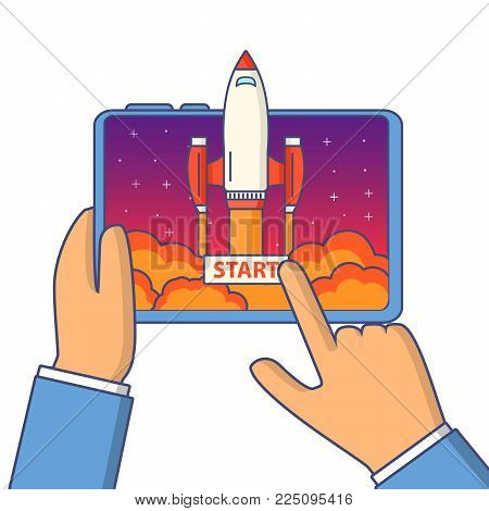 Business concept start up of a rocket and launch of a mobile application.The spacecraft science flying up from the smartphone.The hand hold tablet and the finger touche screen and presses the button