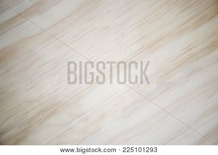 White wooden background with vignette. Yellow natural wood closeup. Light timber ornament. Clean lumber photo. Maple tree board for floor. Wooden table with tree trunk pattern. Warm timber texture