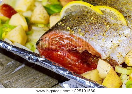 Marinated salmon steaks on metallic plate board marinated with herbs and different spices