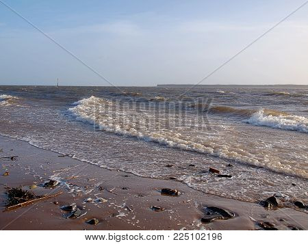 Tay River. Dundee, Scotland - January 27, 2018 Tay River Waves Wash The Beach In The Scottish City O