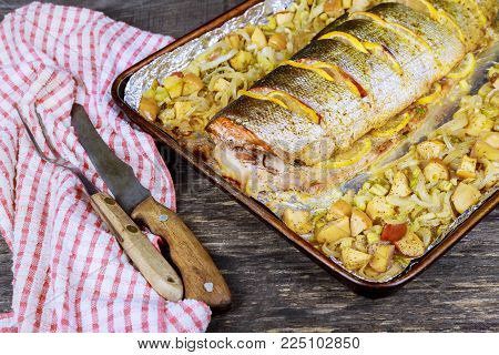 Gourmet oven-baked pink salmon with thinly sliced a delicious seafood starter to a dinner baked salmon in an oven with different spices