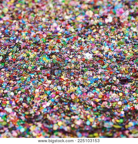 Surface fully coated with colorful sequins as an abstract background texture composition