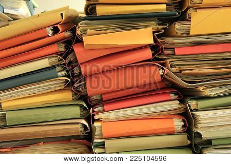 Stacked office files: pile of files in an office
