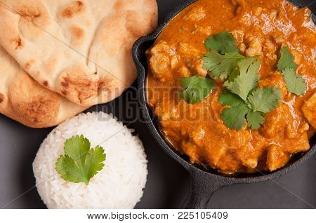 home made chicken korma with rice and naan bread