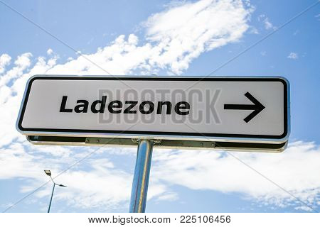 Ladezone - Information sign loading zone in german language - on a light blue background