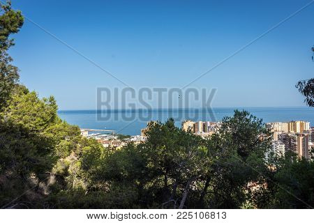 City Skyline Of Malaga Overlooking The Sea Ocean In Malaga, Spain, Europe On A Bright Summer Day Wit