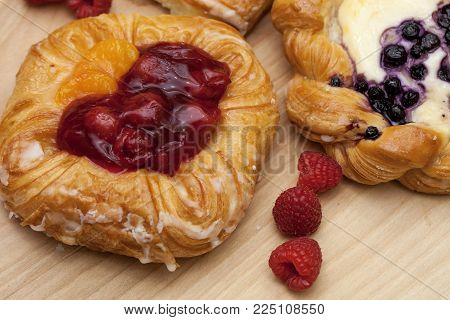 Close Up Of Cheese Danish Puff Pastry With Blackberries And Vanilla Custard