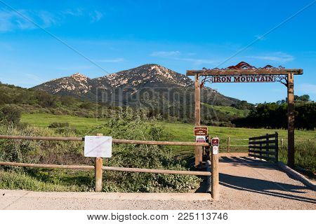 Poway, California - March 16, 2017:  Wooden Fence And Trailhead Sign To The Iron Mountain Trail, A P