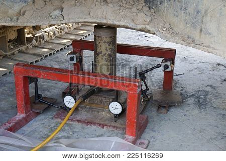 Soil bearing capacity test by Plate load test during applied force and settlement reading
