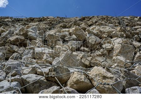 Worm's eye view of Gabion or wire box which filled with rocks use to be retaining wall in construction site
