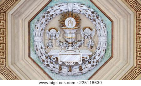 ROME, ITALY - SEPTEMBER 05: Eucharist chalice and wafer, stucco decoration, basilica of Saint Paul Outside the Walls, Rome, Italy on September 05, 2016.