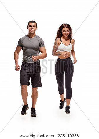 Healthy man and woman keeping fit and running together