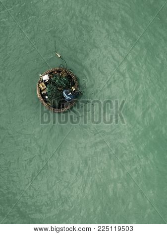 drone view of Vietnamese fisher man alone on the ocean