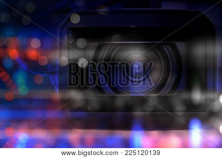 professional video camcorder in studio with blurred bokeh dark background