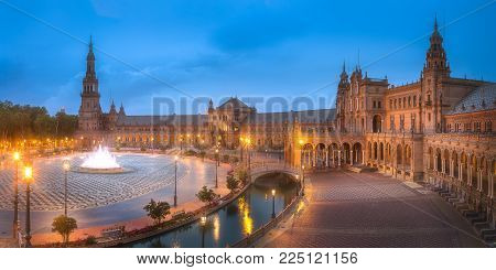 Night view of Spain Square on sunset, landmark in Renaissance Revival style, Seville, Andalusia, Spain.