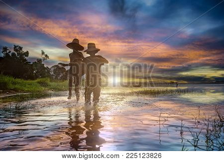 Young asian kids fisherman run and casting freshwater fish in nature river in the early morning golden light.