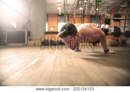 Trained man doing exercise