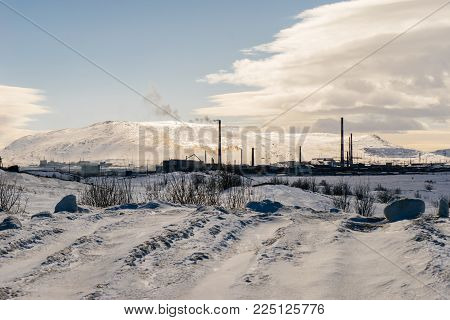 snow-covered field in winter against the backdrop of beautiful mountains