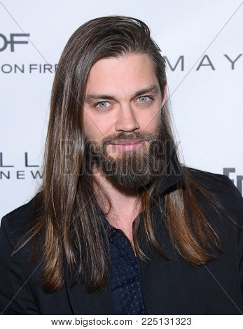 LOS ANGELES - JAN 20:  Tom Payne arrives for the EW Magazine honors SAG Nominees on January 20, 2018 in West Hollywood, CA