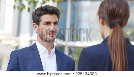 Business people talking to each other outside office
