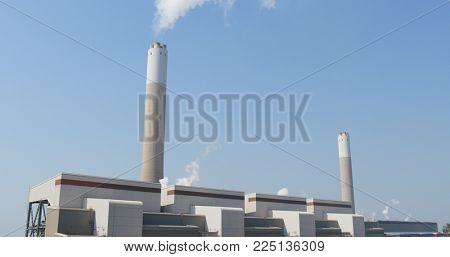 Smoke stack on blue sky