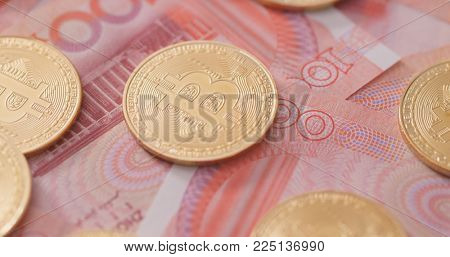 Bitcoin and chinese banknote, RMB