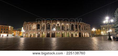 Arena of Verona at night, world heritage site - I-III century - Roman amphitheater in Bra Square (Piazza Bra) Veneto, Italy, Europe
