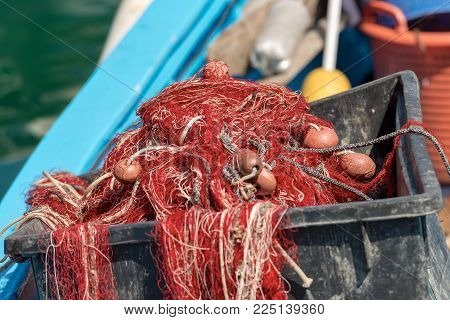 Close Up Of Fishing Nets With Ropes And Floats On A Boat In The Harbor