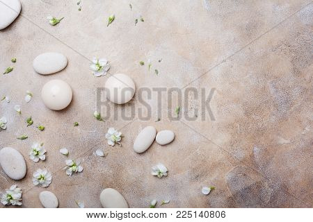 Natural beauty, aromatherapy and spa stone background decorated with flowers. Top view. Flat lay.