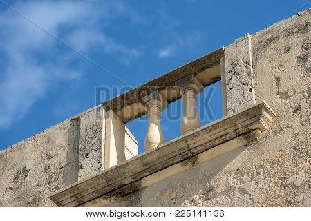 Close-up Of An Old Balustrade In The Ortygia Island (isola Di Ortigia). Syracuse (siracusa) - Sicily