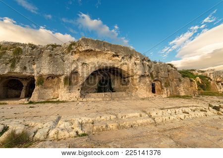 Artificial Caves (grotta Del Ninfeo - Cave Of The Nymphaeum). Greek Roman Amphitheater In Syracuse C