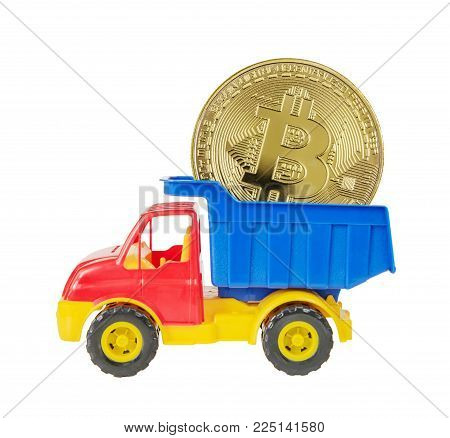 Multicolored plastic toy lorry delivers a symbolic coin of bitcoin crypto currency, new digital money in cyber world, isolated on white background