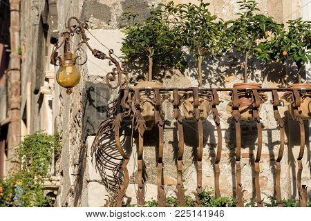 Close-up Of A Typical Balcony In Wrought Iron In The Taormina Town, Sicily Island, Messina, Italy, E