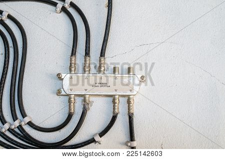 Cable Television System by Wire with Cable Signal Splitter in Apartment.
