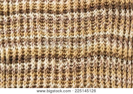 Knitted background. Knitting Pattern. Knitted texture. A sample of knitting from wool.
