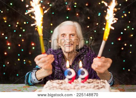 Happy grandma celebrating her 99th birthday with fire