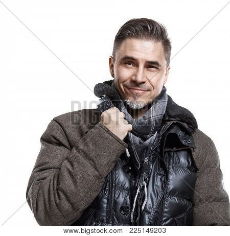 Happy older white man in casual coat isolated on white.