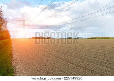 Beatiful sunset above the modern high powerlines on the field poster