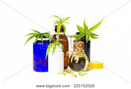 Marijuana oil bottles and leafs isolated on white