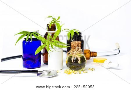 Marijuana oil bottles with leafs and stethoscope isolated